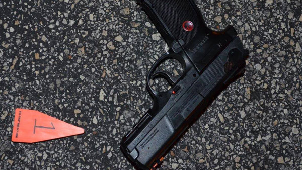 A Ruger pellet gun was found on the pavement in the area where a suspect was shot in the leg.