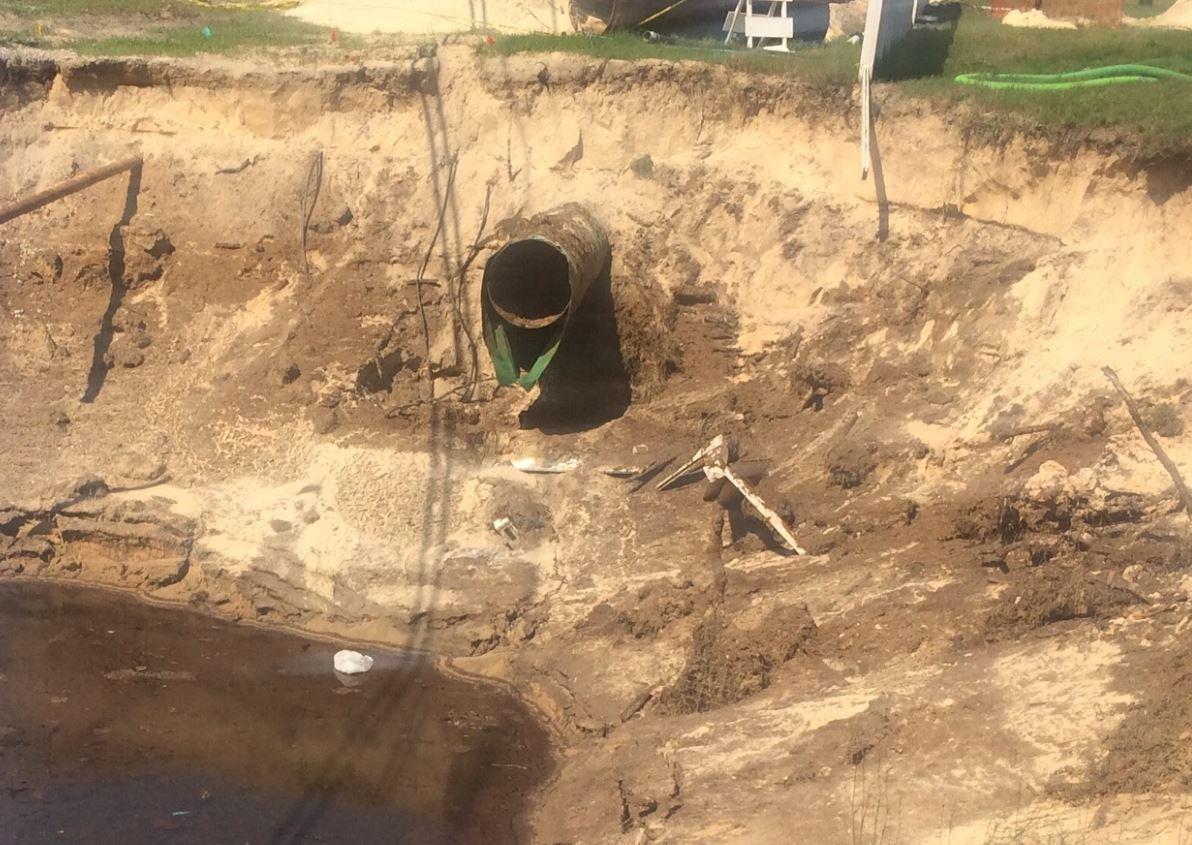 This photo taken on Monday, April 4 shows a pipe that's being used to drain the sinkhole.