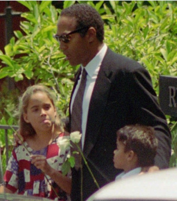 O.J. Simpson, with daughter Sydney, 8, and son Justin, 6, arrives at a private funeral for his ex-wife Nicole Brown Simpson in the Brentwood section of Los Angeles Thursday, June 16, 1994. (AP Photo/Eric Draper)