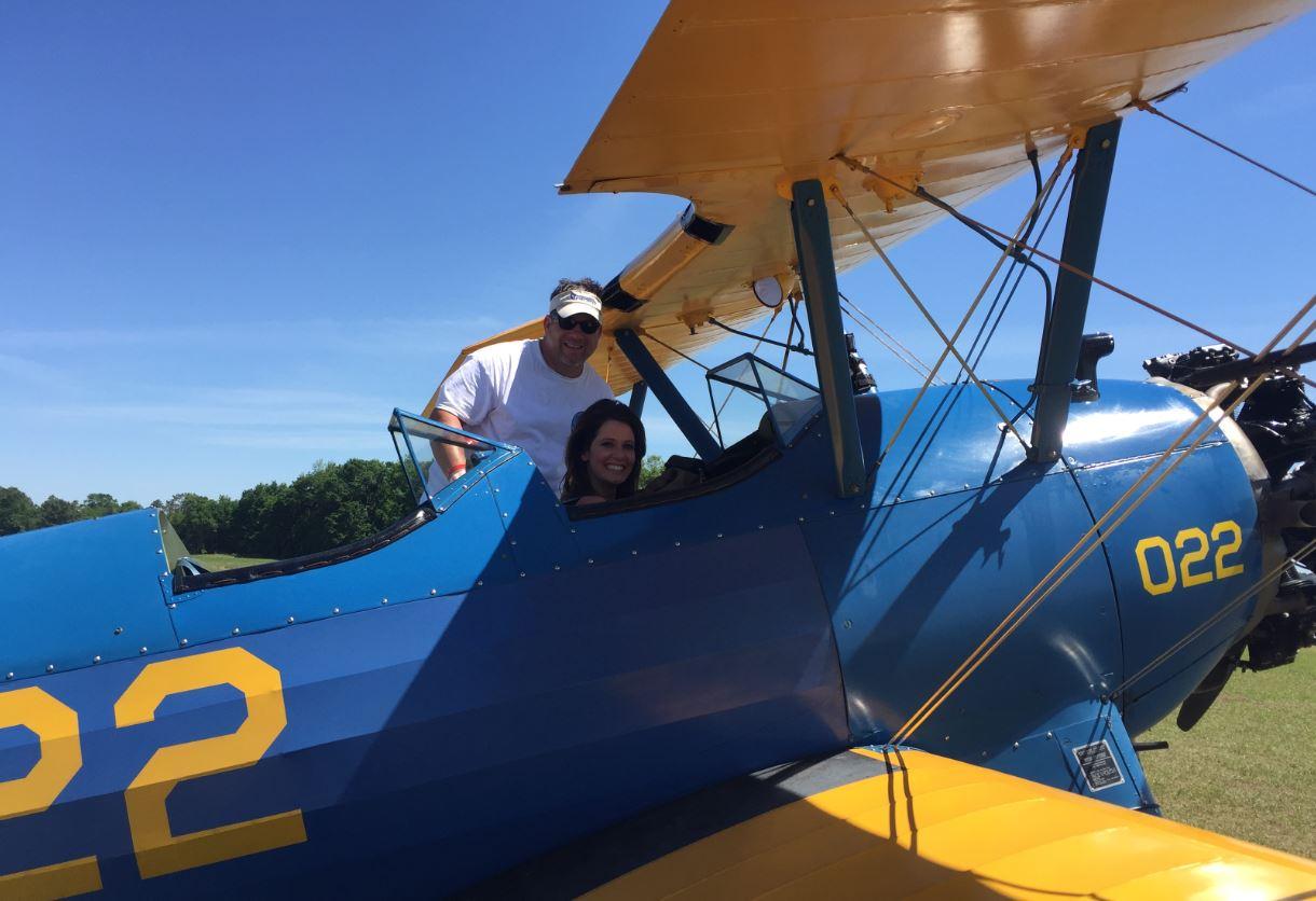 News Channel 8's Melissa Marino inside a vintage plane at Sun n' Fun.