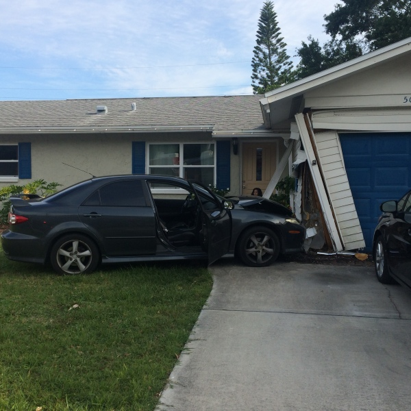 car hit home_144153