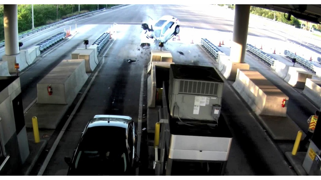 Watch Man Flies Out Of Car Onto Toll Booth After High Speed Crash