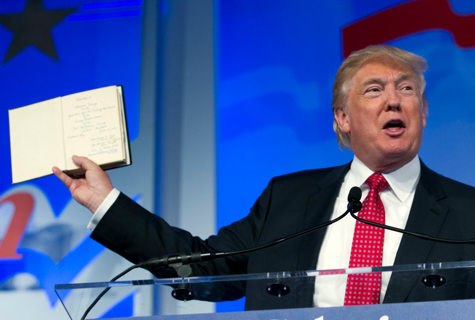 trump holds up bible-846653543