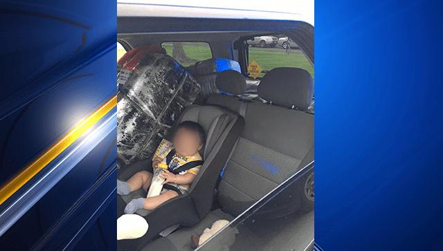 baby in backseat 1_1555105765546.png-3156096.jpg
