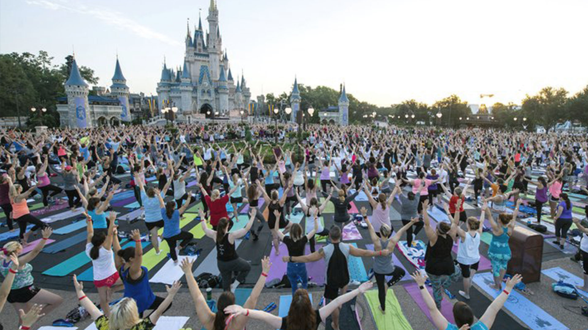 Thousands Of Employees Do Yoga In Front Of Disney Castles