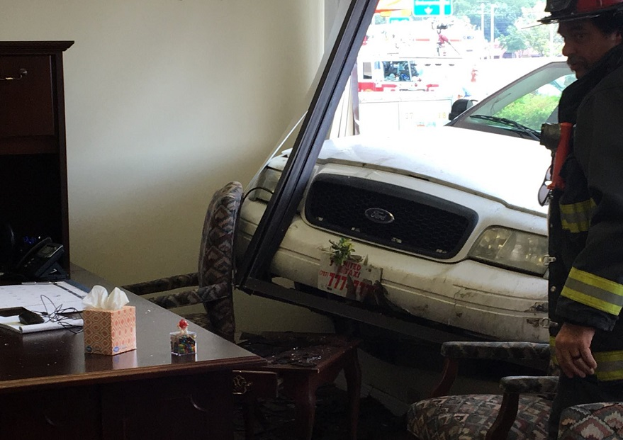 Taxi, car slam into building after traffic incident in