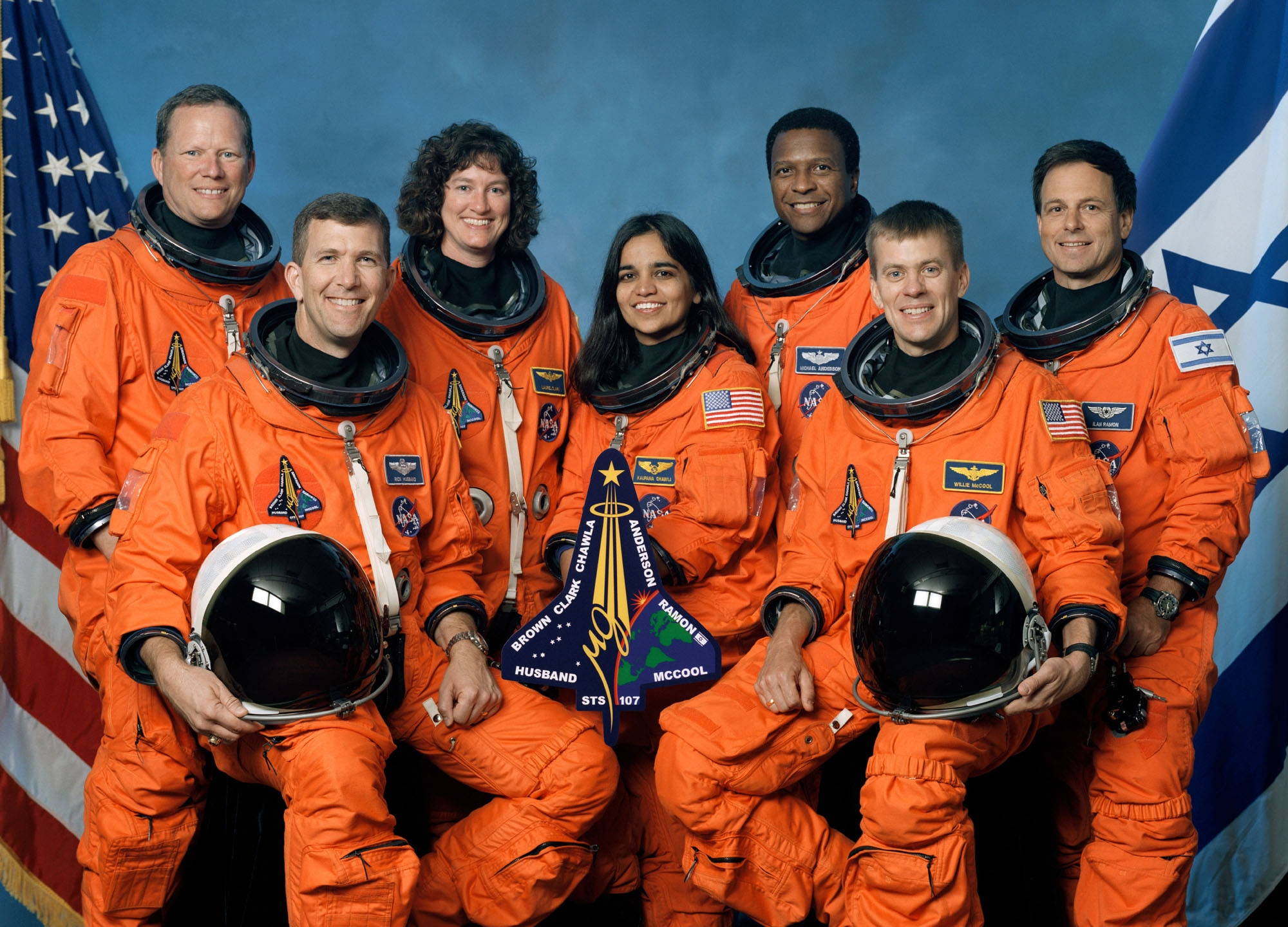 This is the official crew photograph from mission STS-107 on the Space Shuttle Columbia. From left to right are mission specialist David Brown, commander Rick Husband, mission specialist Laurel Clark, mission specialist Kalpana Chawla, mission specialist Michael Anderson, Pilot William McCool, and Israeli payload specialist Ilan Ramon. All were killed when the shuttle disintegrated over Texas in February 2003